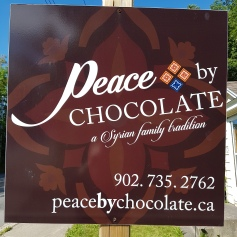 peace by chocolate sign